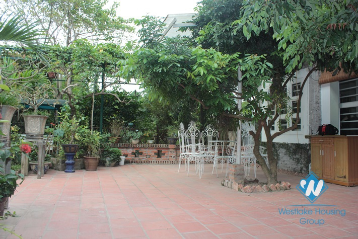 Small house with large garden available for rent in An Duong street, Tay Ho district, Hanoi