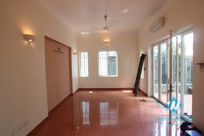 4-floor house with nice yard for rent in Tay Ho district .